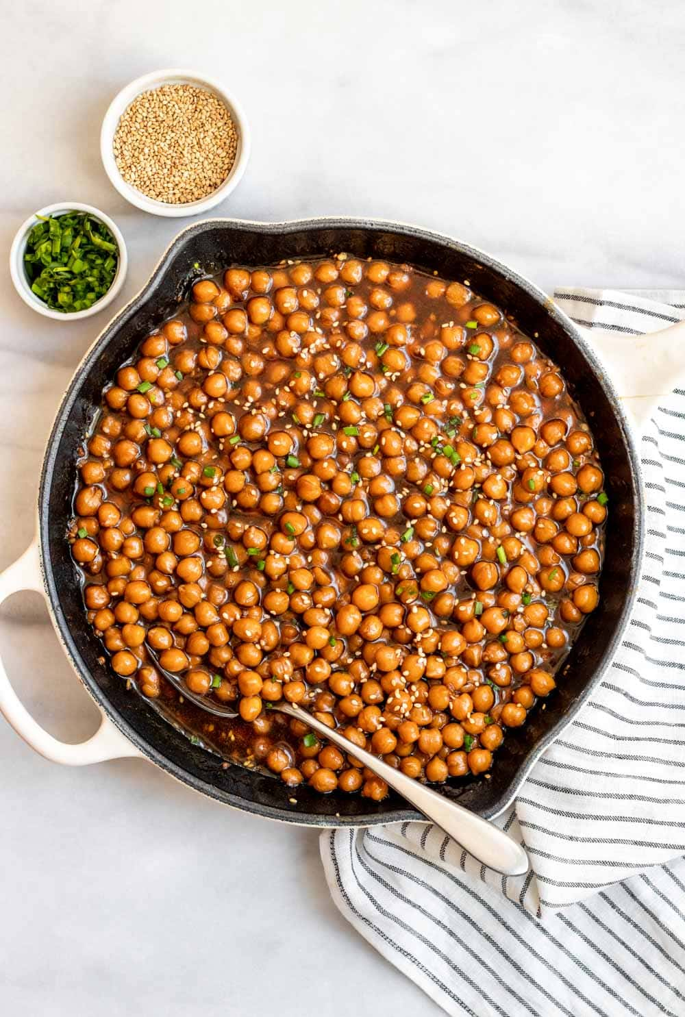 Easy chickpea recipe with chives and sesame seeds on top.