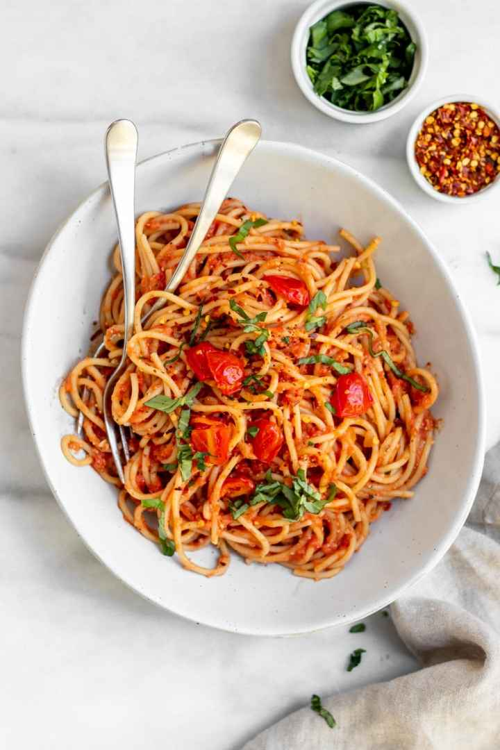 Spaghetti pomodoro with sauteed tomatoes on top.