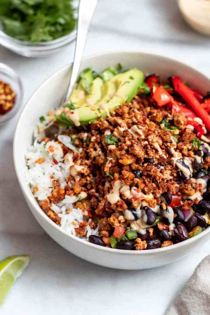 Taco bowl with walnut meat, veggies, beans, and rice.