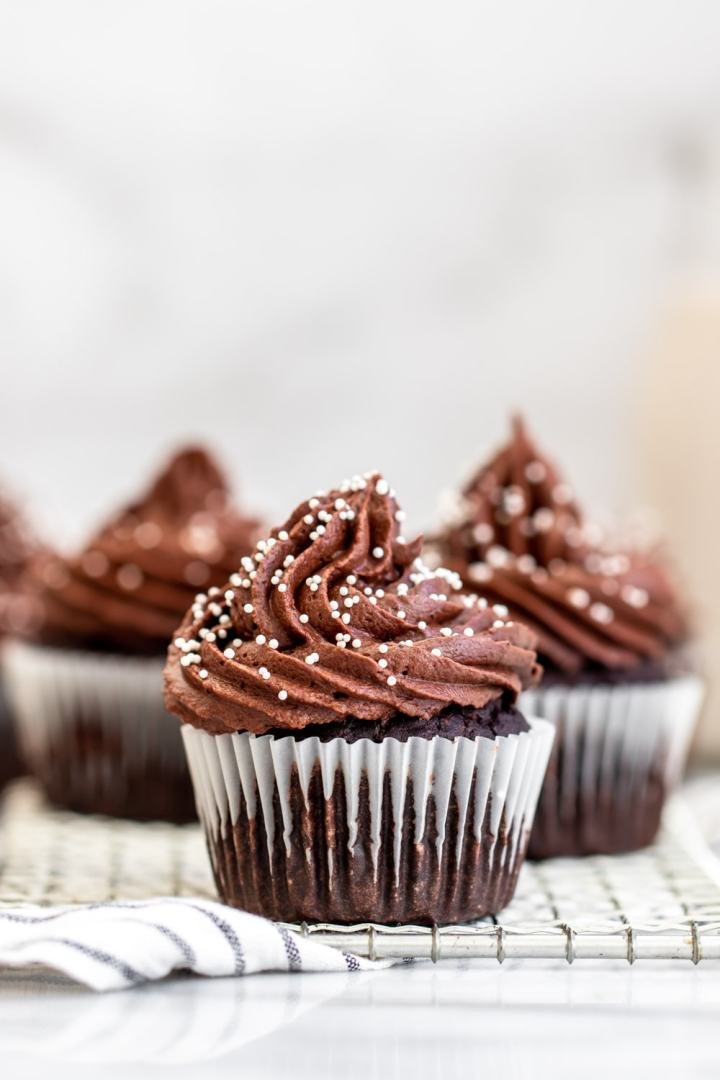 Gluten free chocolate cupcakes with white sprinkles.