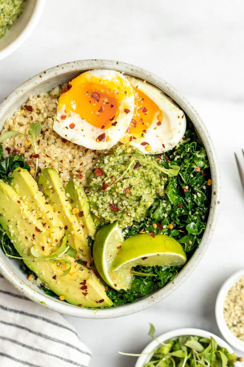 Up close of quinoa breakfast bowl with red pepper flakes on top.