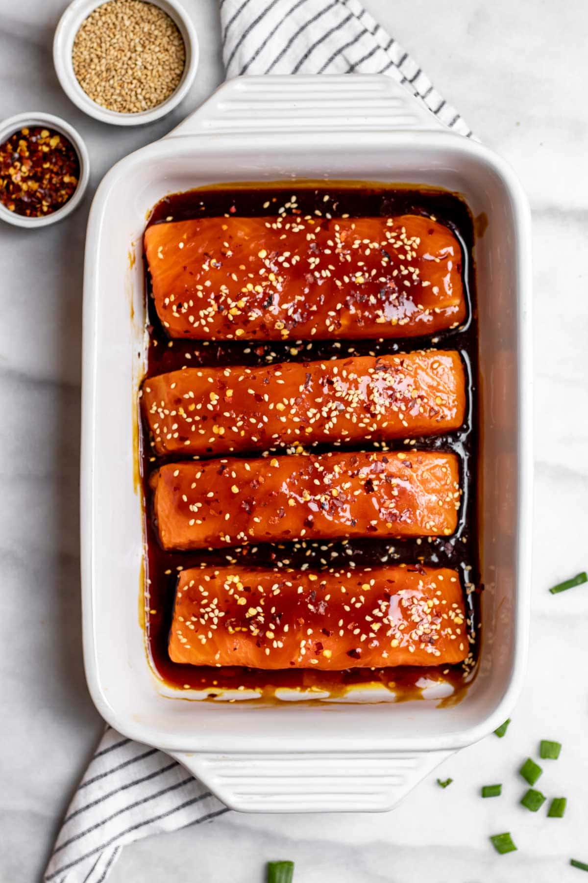 Salmon before going in the oven on a baking sheet.