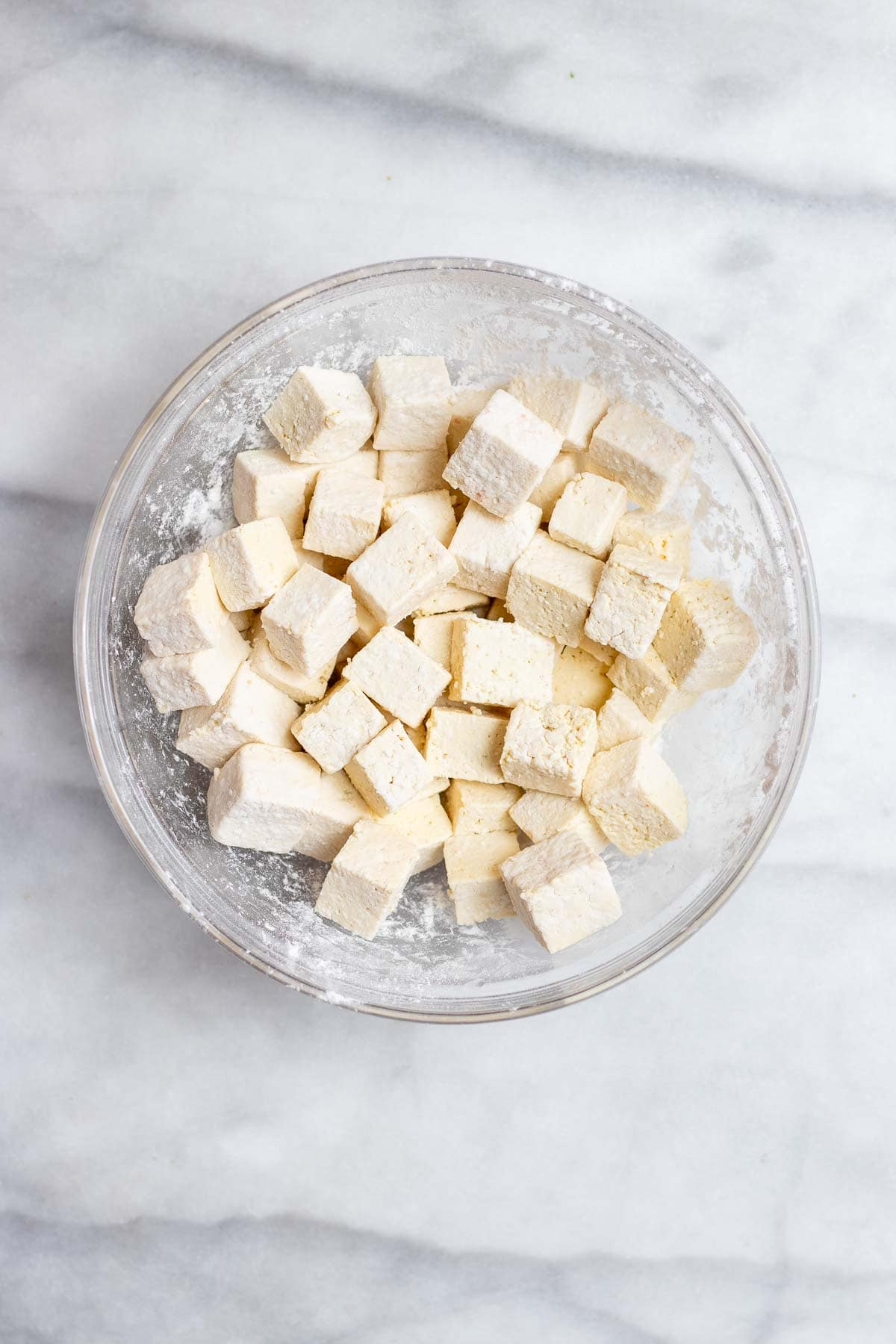 Glass bowl with cubbed tofu.