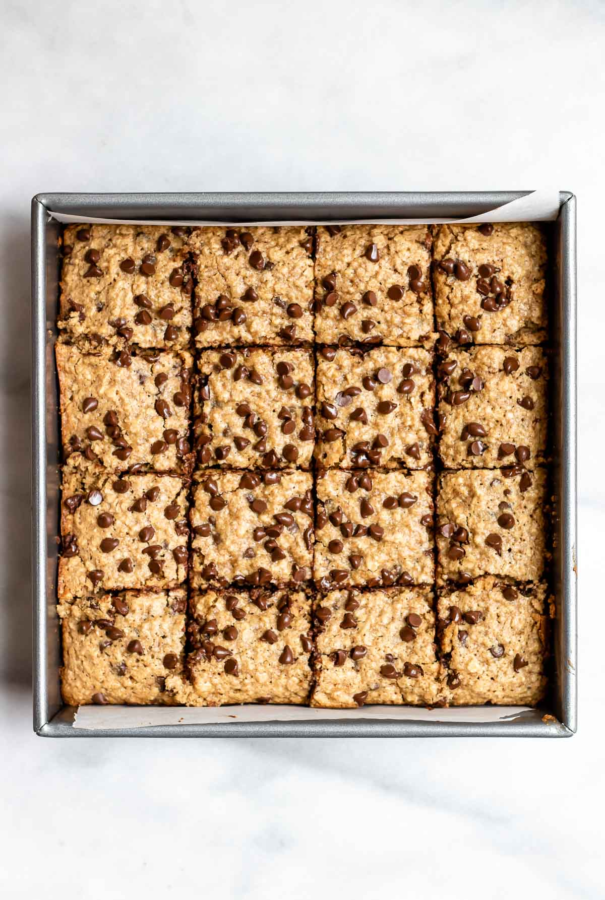 Cookie bars in a baking pan after coming out of the oven.