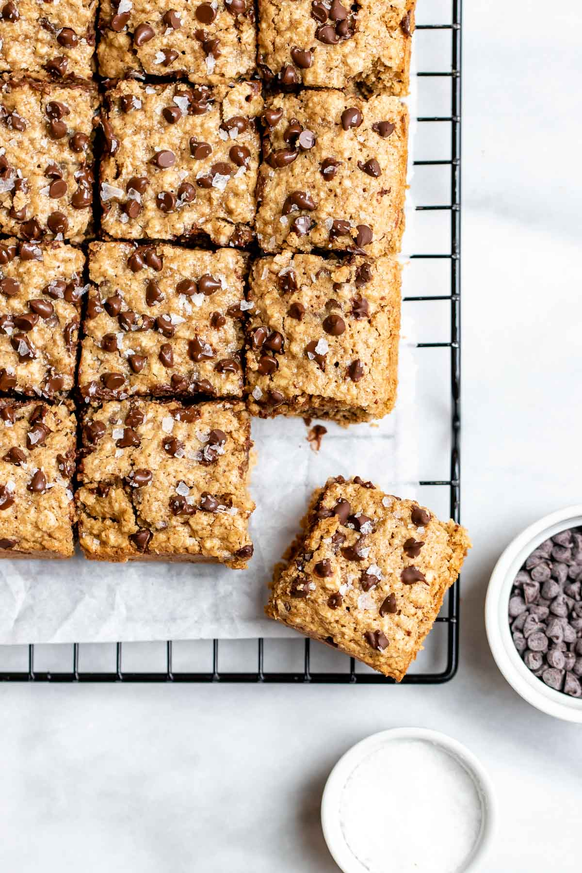 Oatmeal chocolate chip bars on a cooling rack sliced into squares.