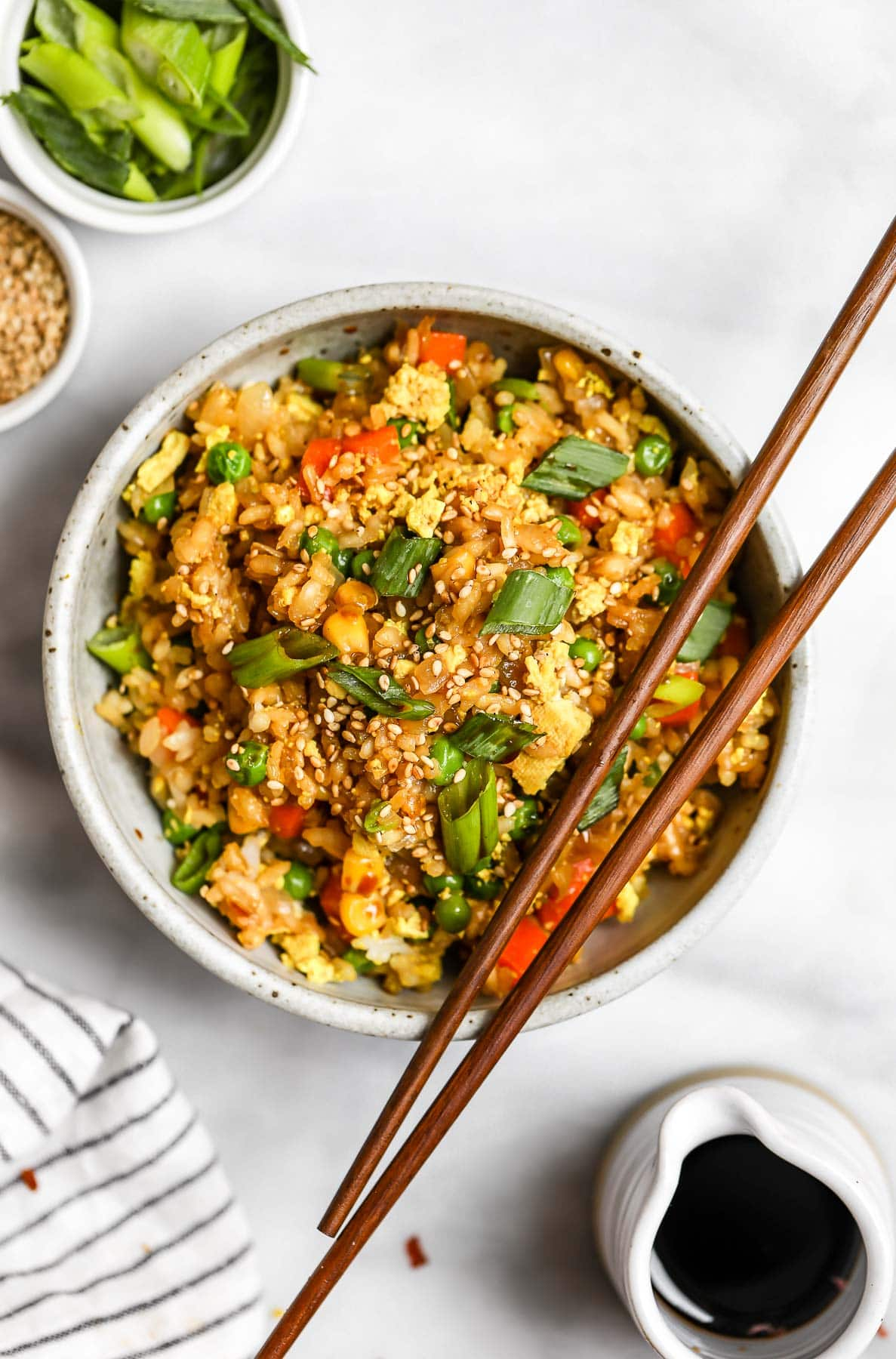 One bowl of vegan fried rive with chopsticks on the top.