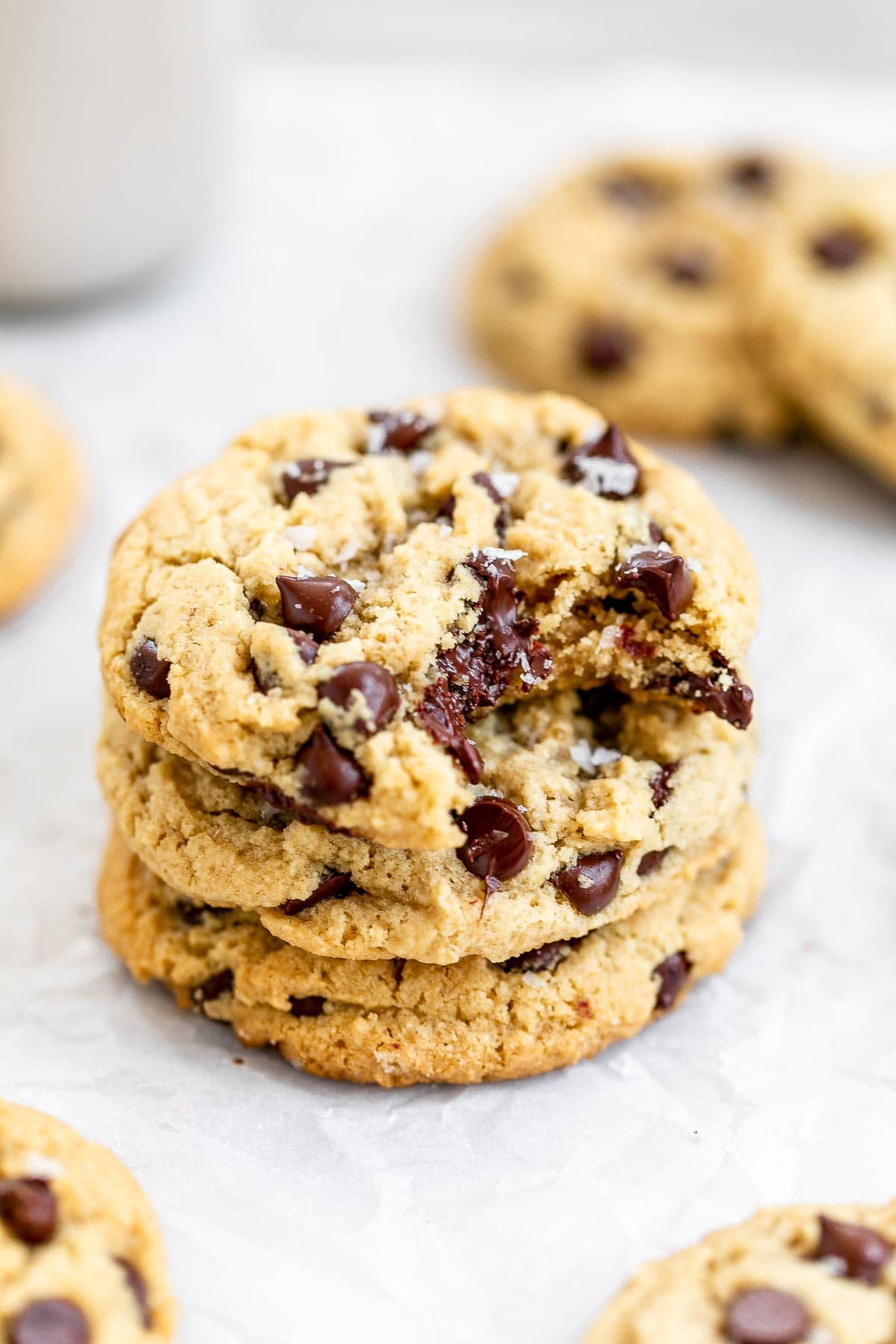 Three almond flour cookies stacked on each other with melted chocolate.