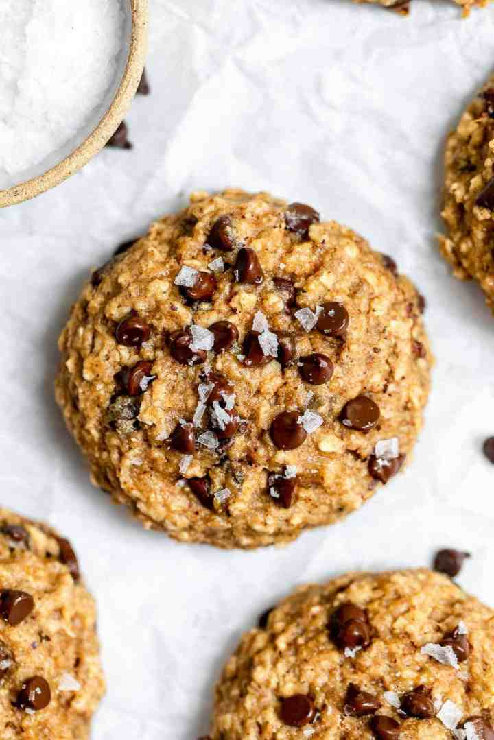 Chocolate chip banana breakfast cookie on parchment paper.