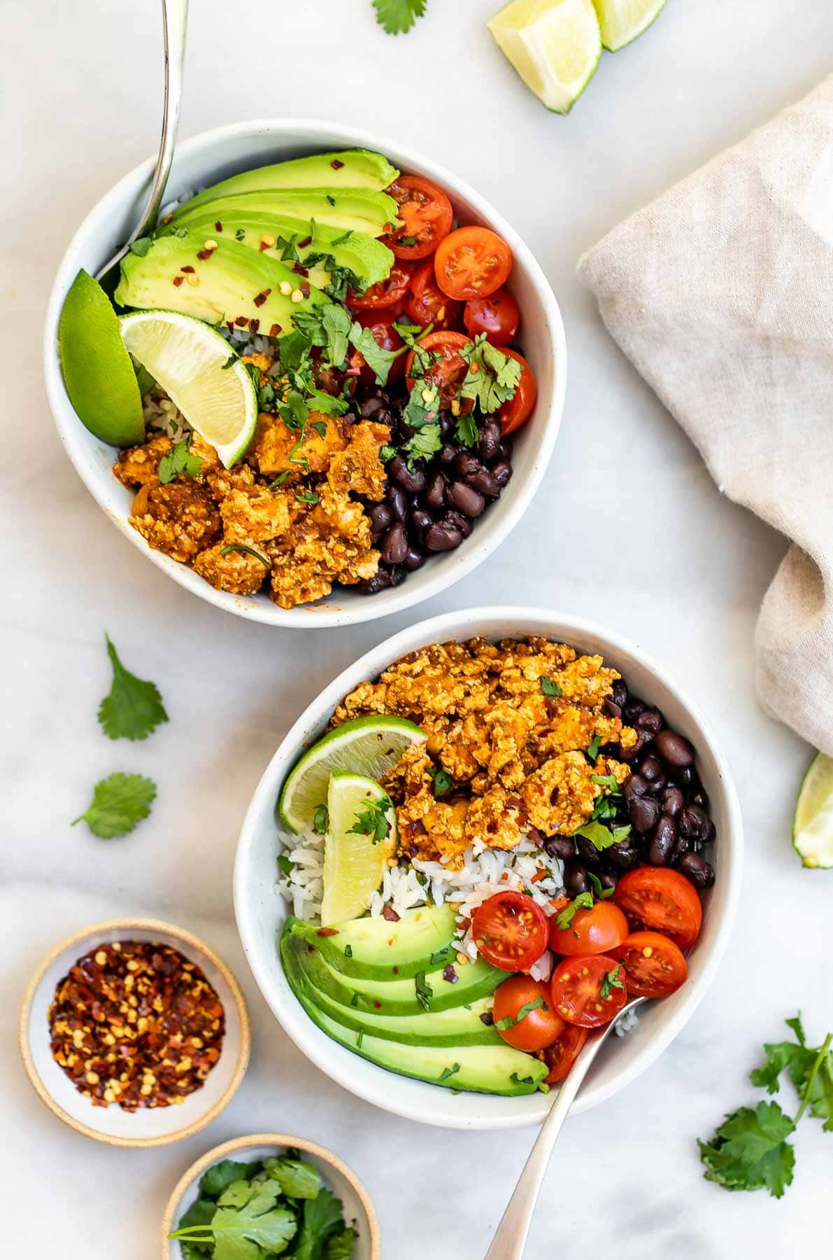 Two bowls with the sofritas recipe with rice, beans and avocado.