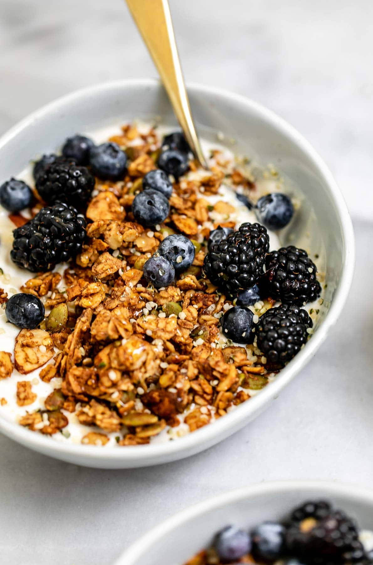 Gluten free granola on top of yogurt with berries.