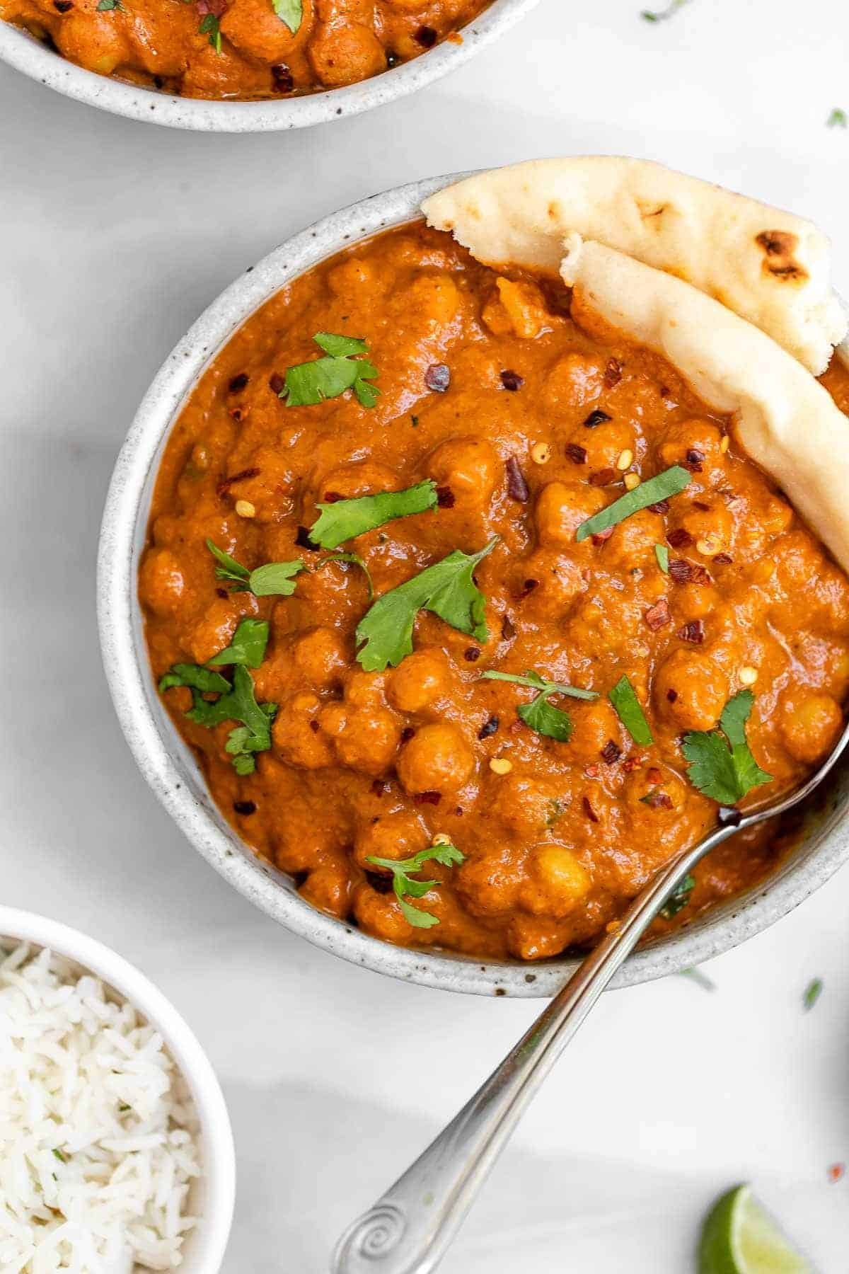 Close up image of the vegan chickpea tikka masala in a round bowl.