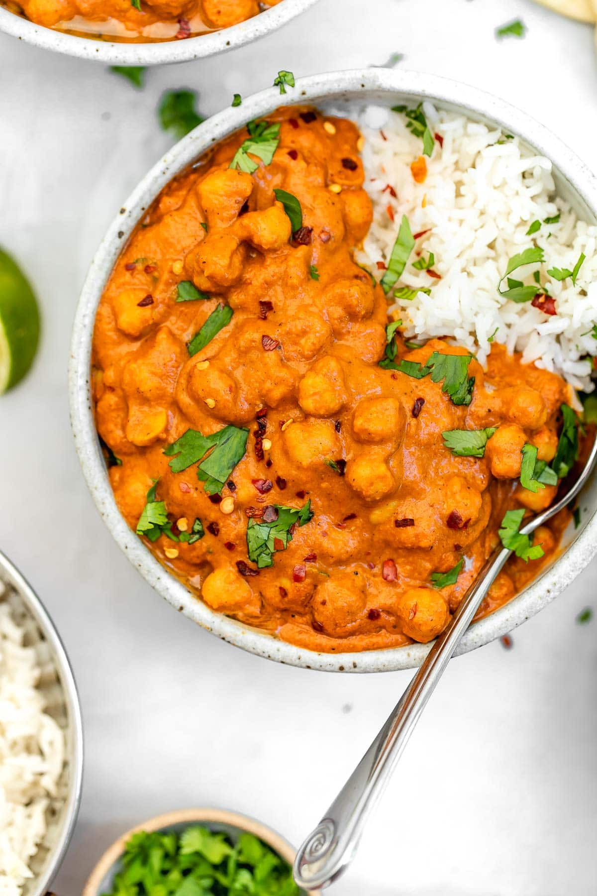Overhead shot of the chickpea masala with cilantro and red pepper flakes.
