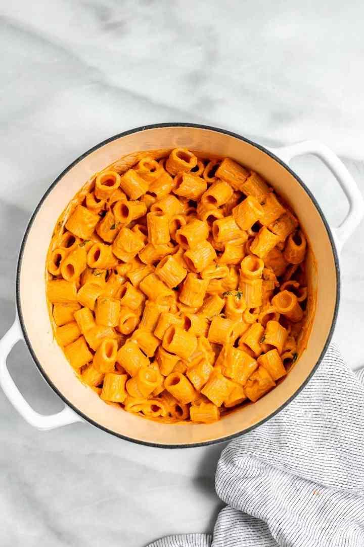Vodka pasta with rigatoni in a large white pot.