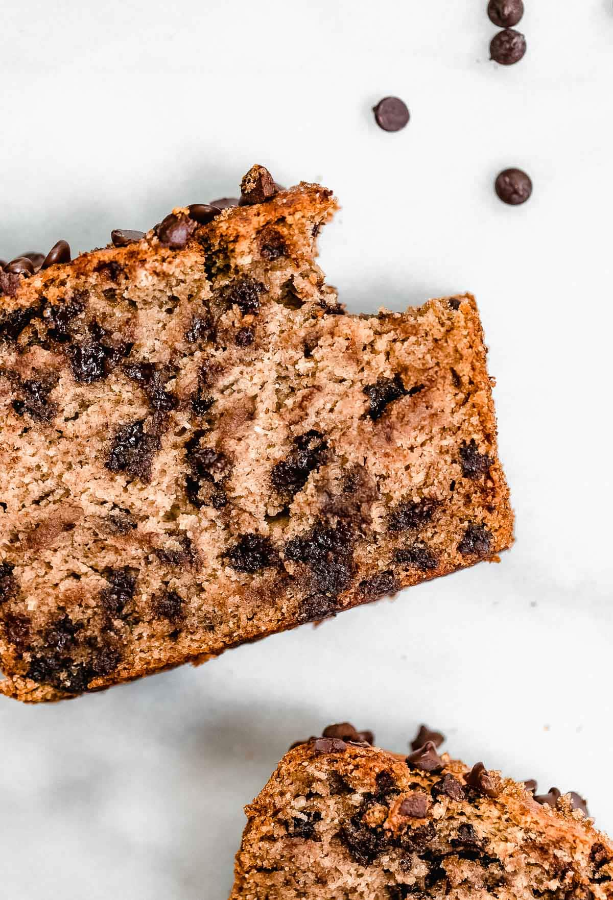 Chocolate chip banana bread with one bite taken out.