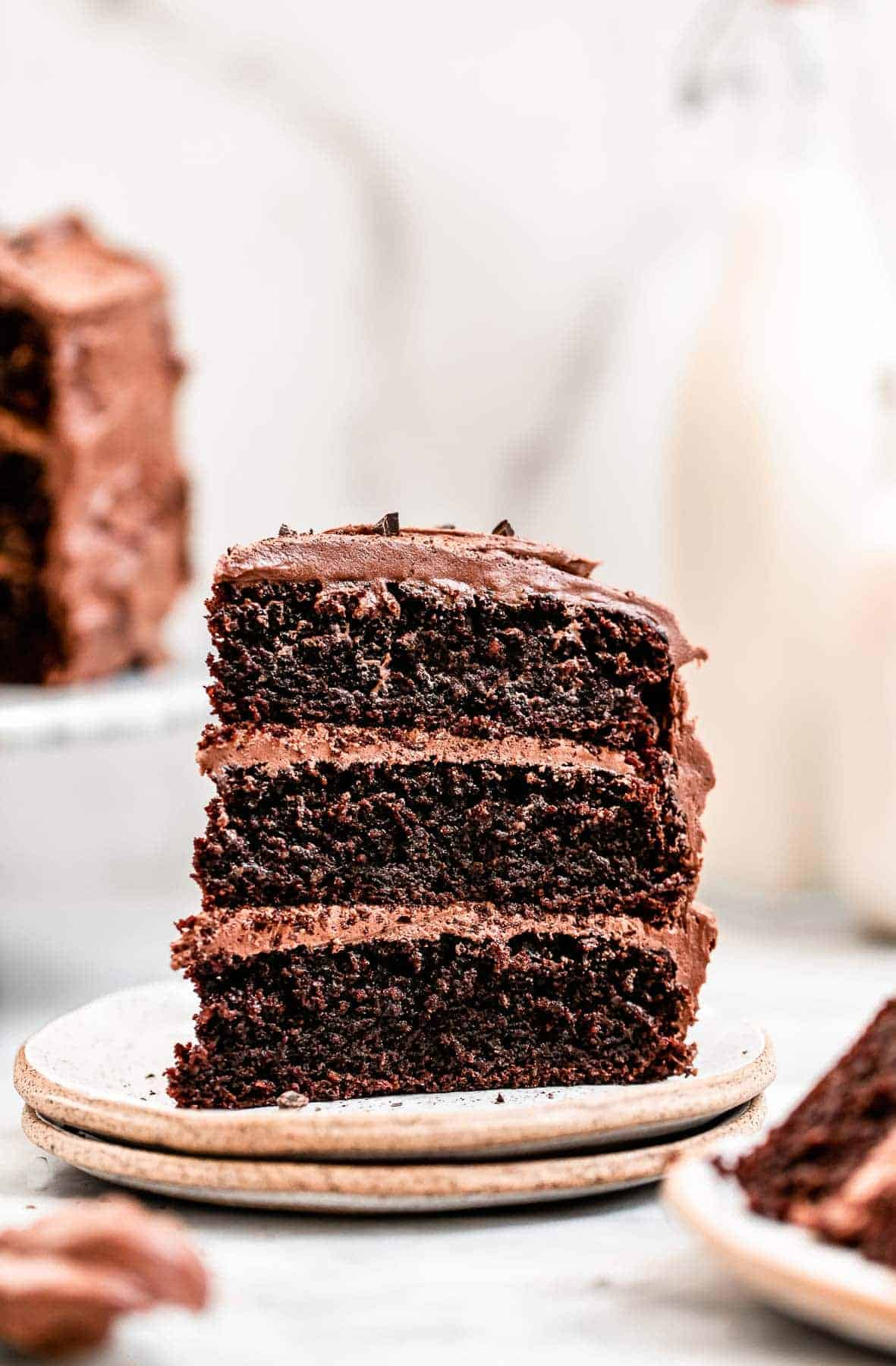 Three layer paleo chocolate cake on a plate.