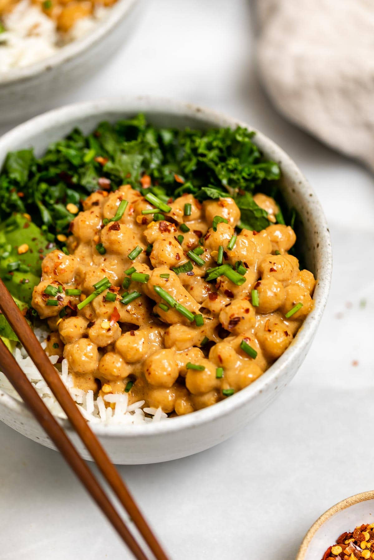 Veggie buddha bowl with chickpeas, rice and kale.