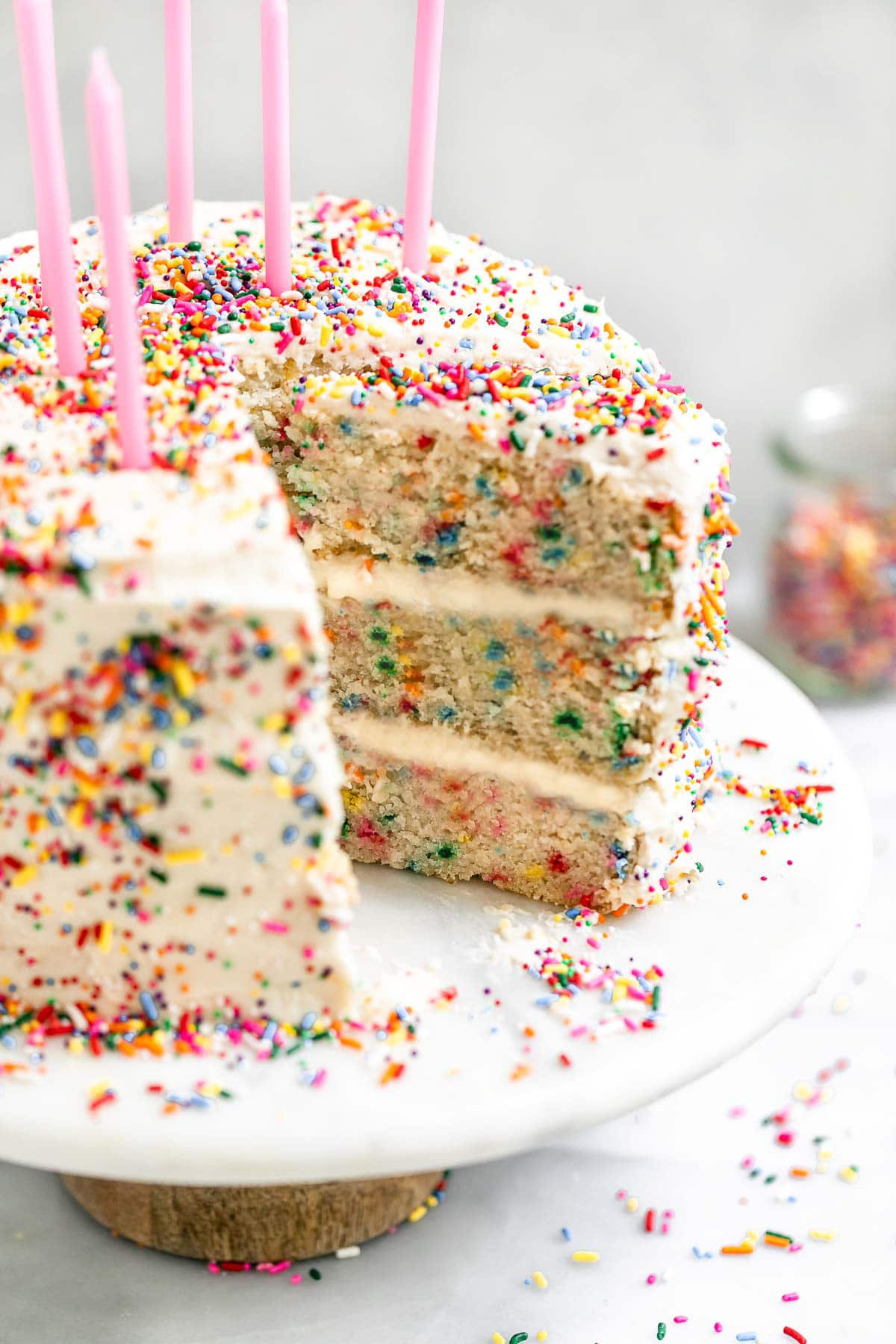 vegan gluten free funfetti cake on a cake stand.