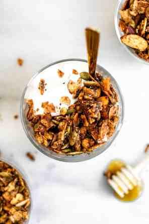 Paleo granola with honey on top.