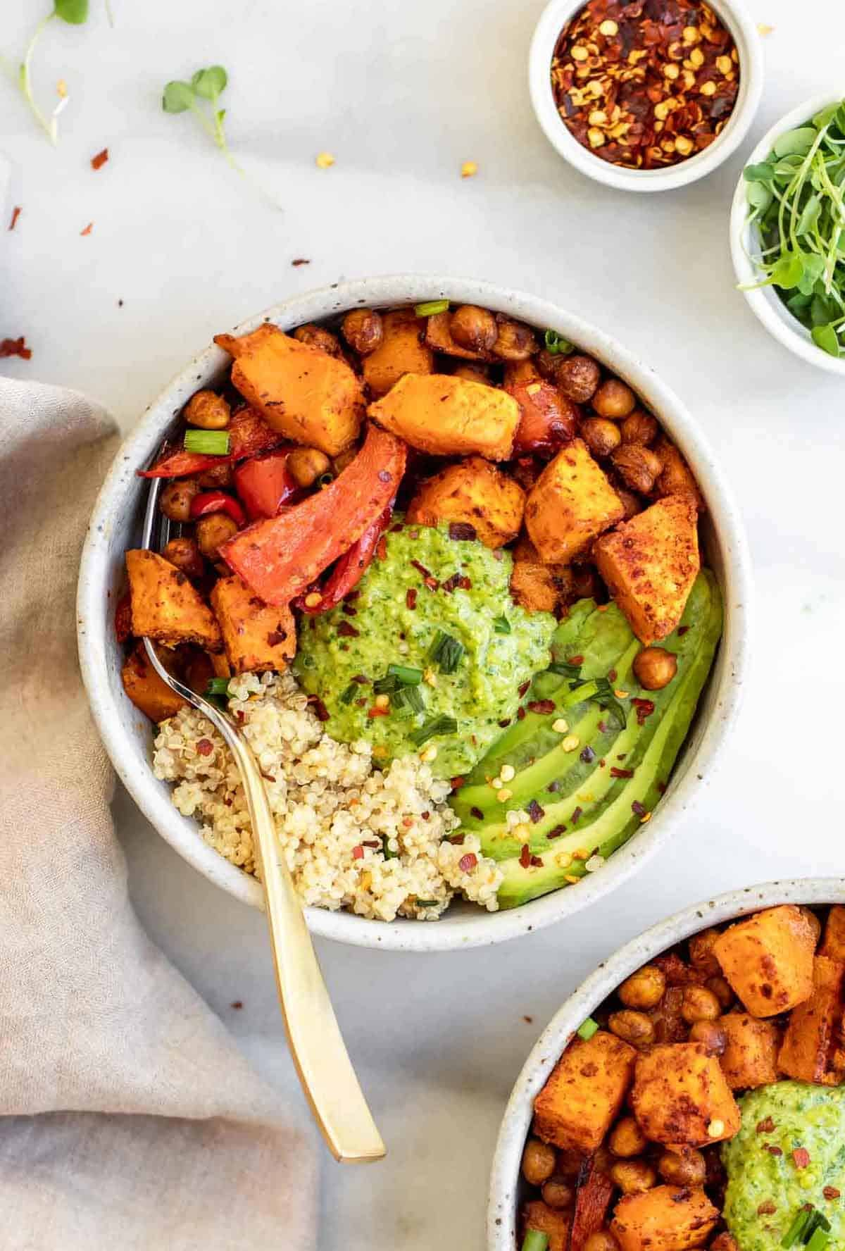 Vegan buddha bowl with sweet potato and pesto.