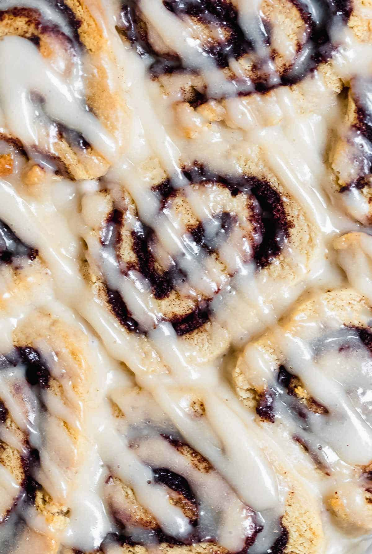 Up close image of cinnamon rolls to show gooey texture.