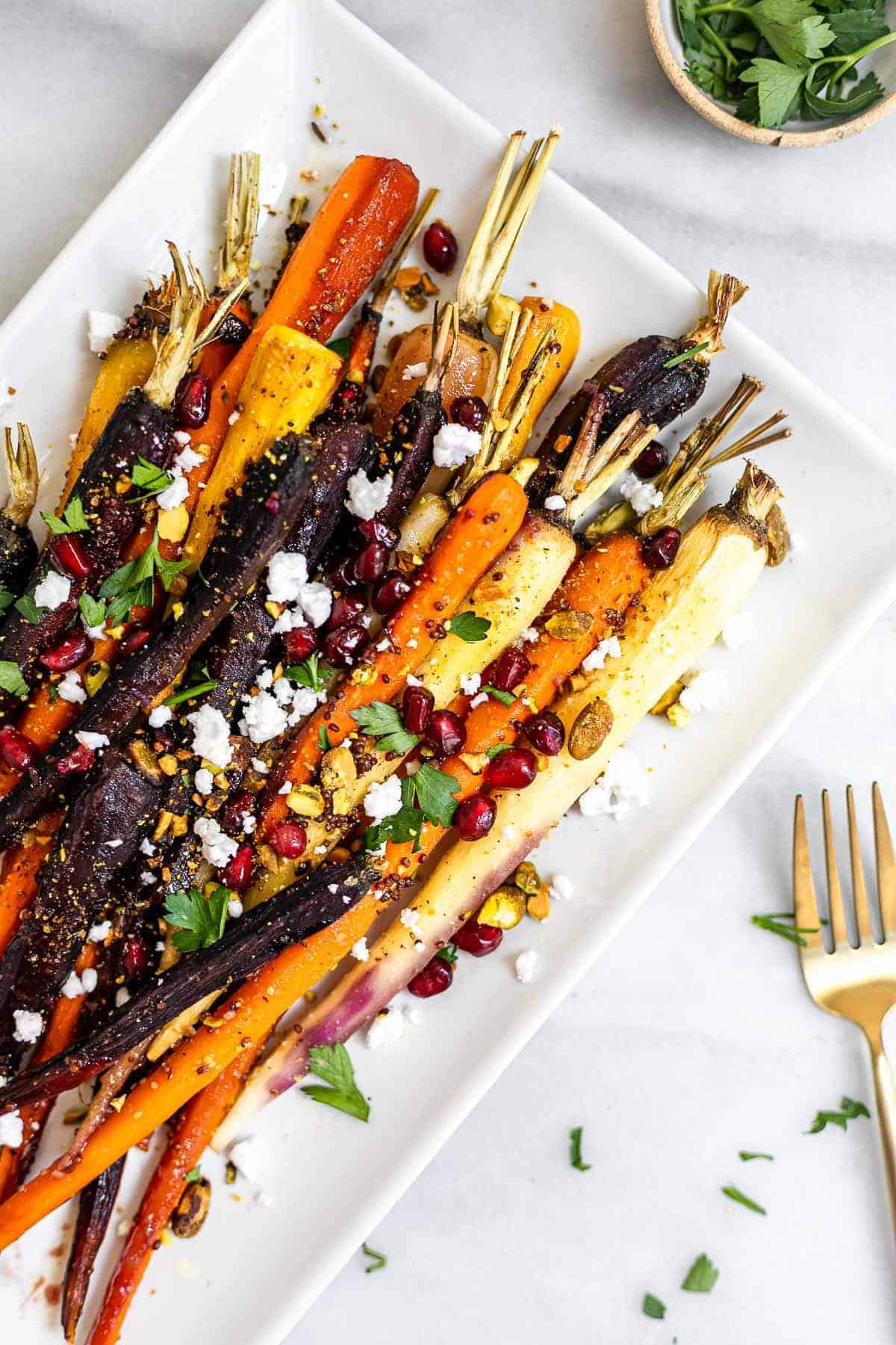 Final rainbow roasted maple glazed carrots with pistachios and feta.