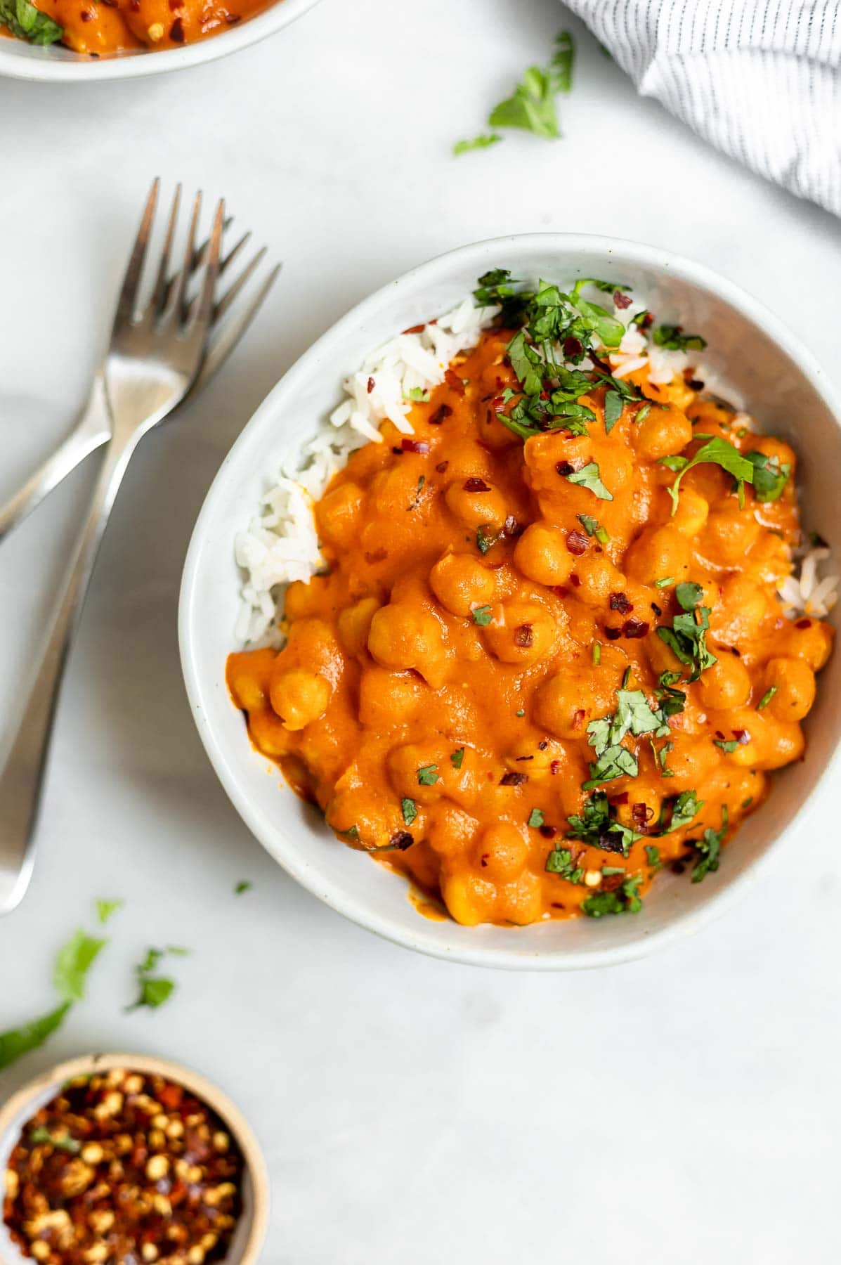 Thai chickpea curry in a bowl with rice.