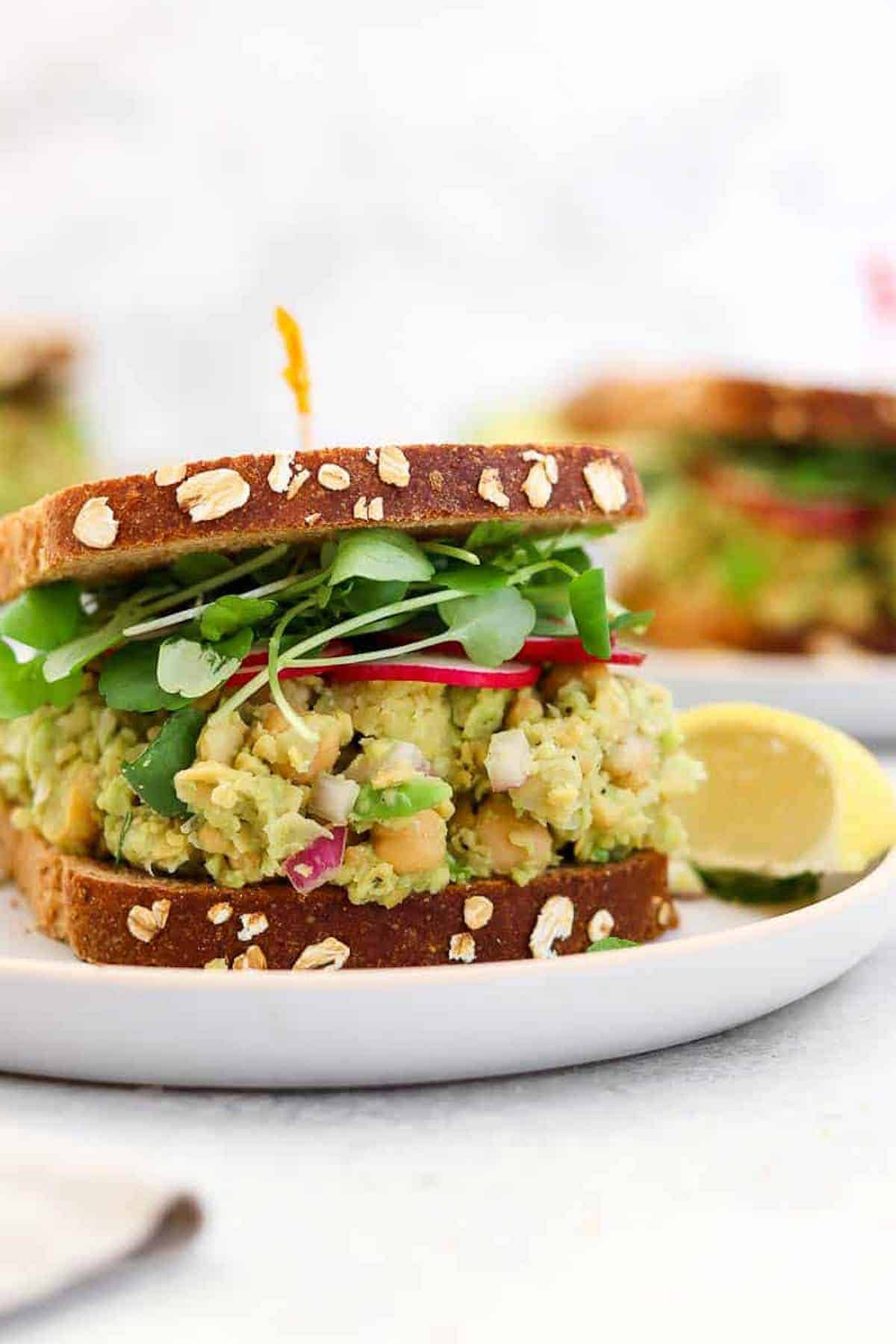 Chickpea avocado salad with radishes on bread.