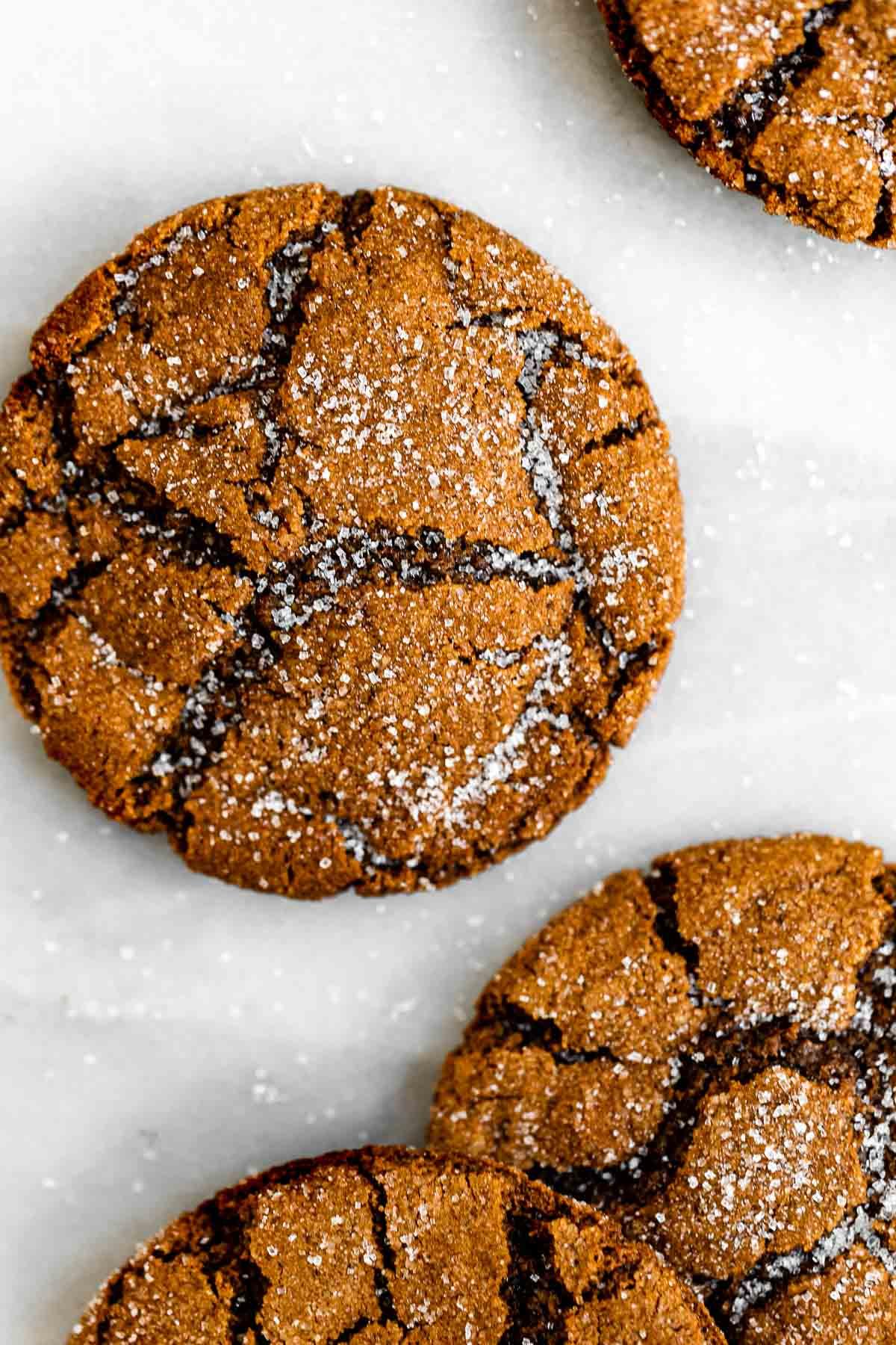 Vegan molasses cookies with sugar on top.