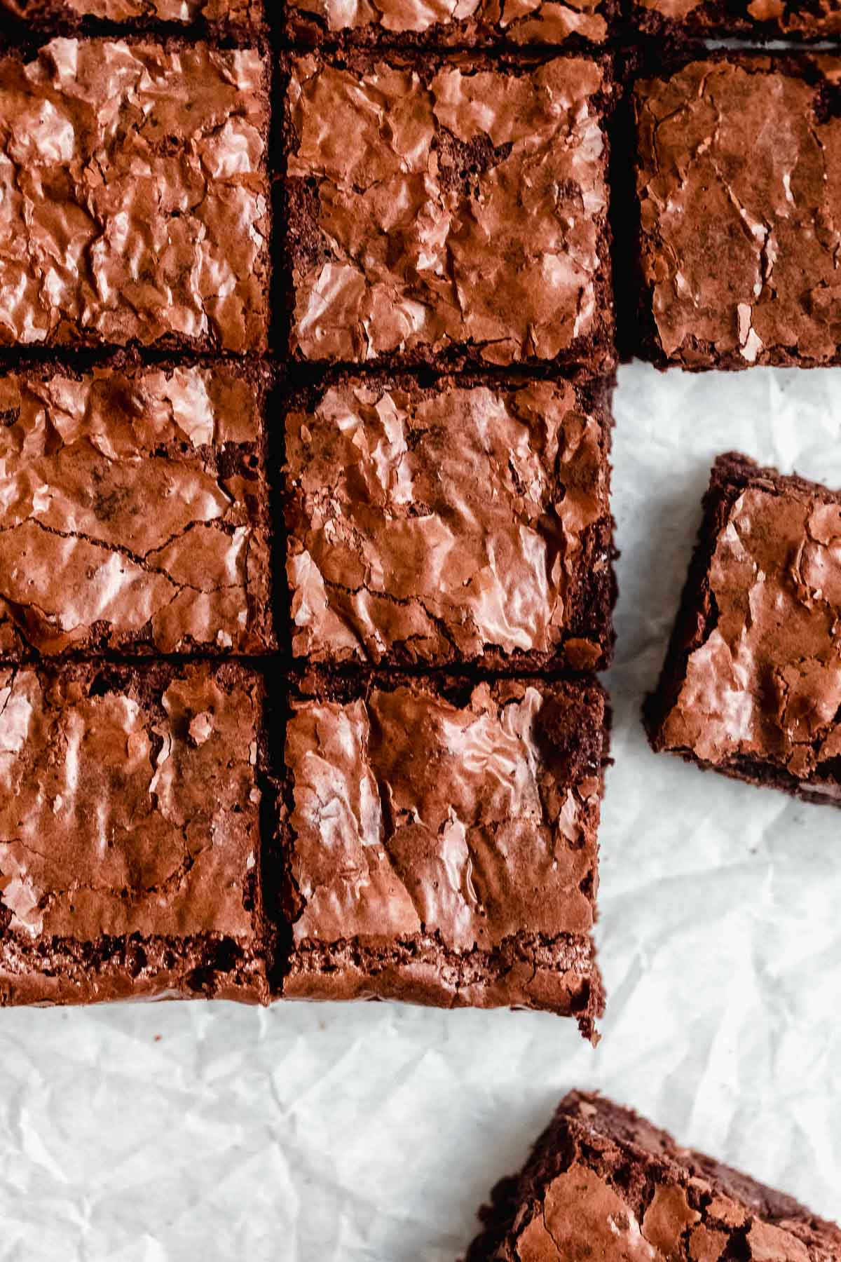final brownies cut into even squares on parchment paper