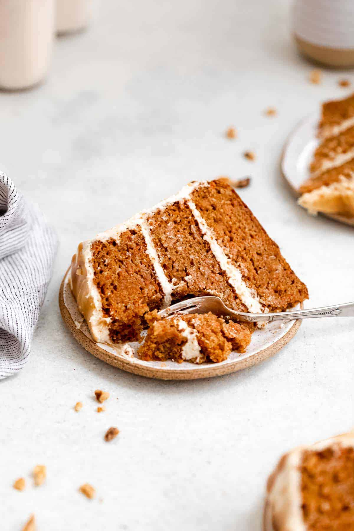three plates with slices of the gluten free carrot cake with a fork on the side