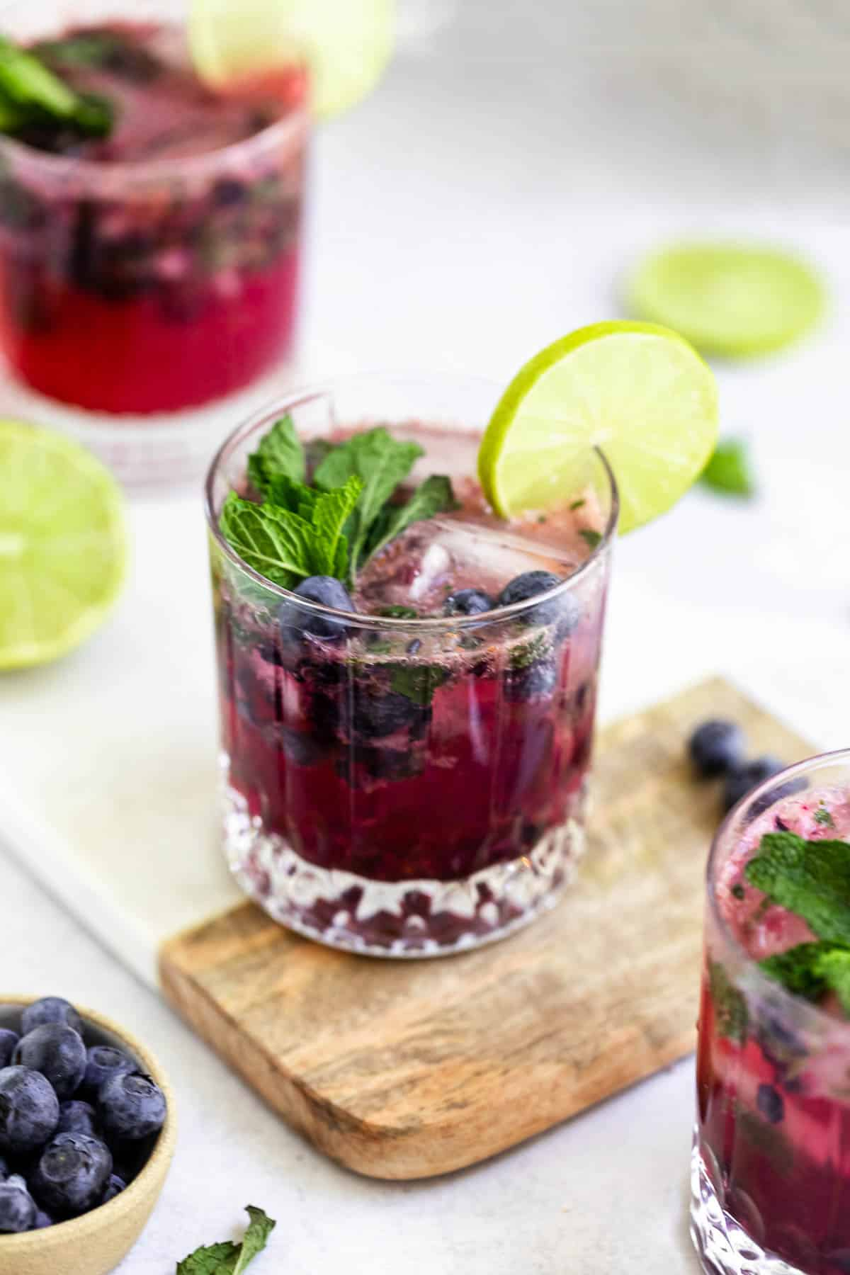fresh blueberry mojito in a glass with mint leaves