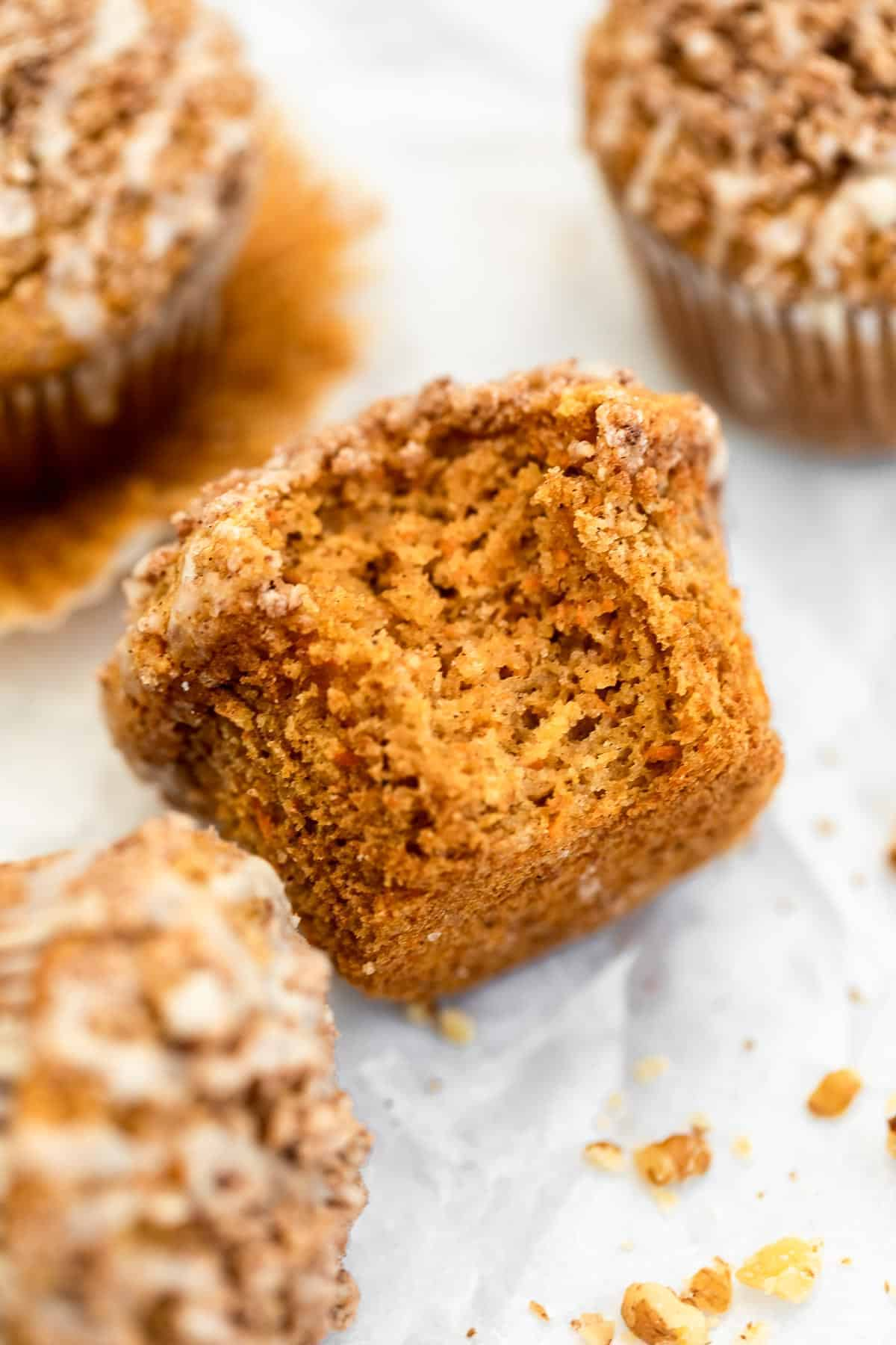 one carrot cake muffin with a bite taken out