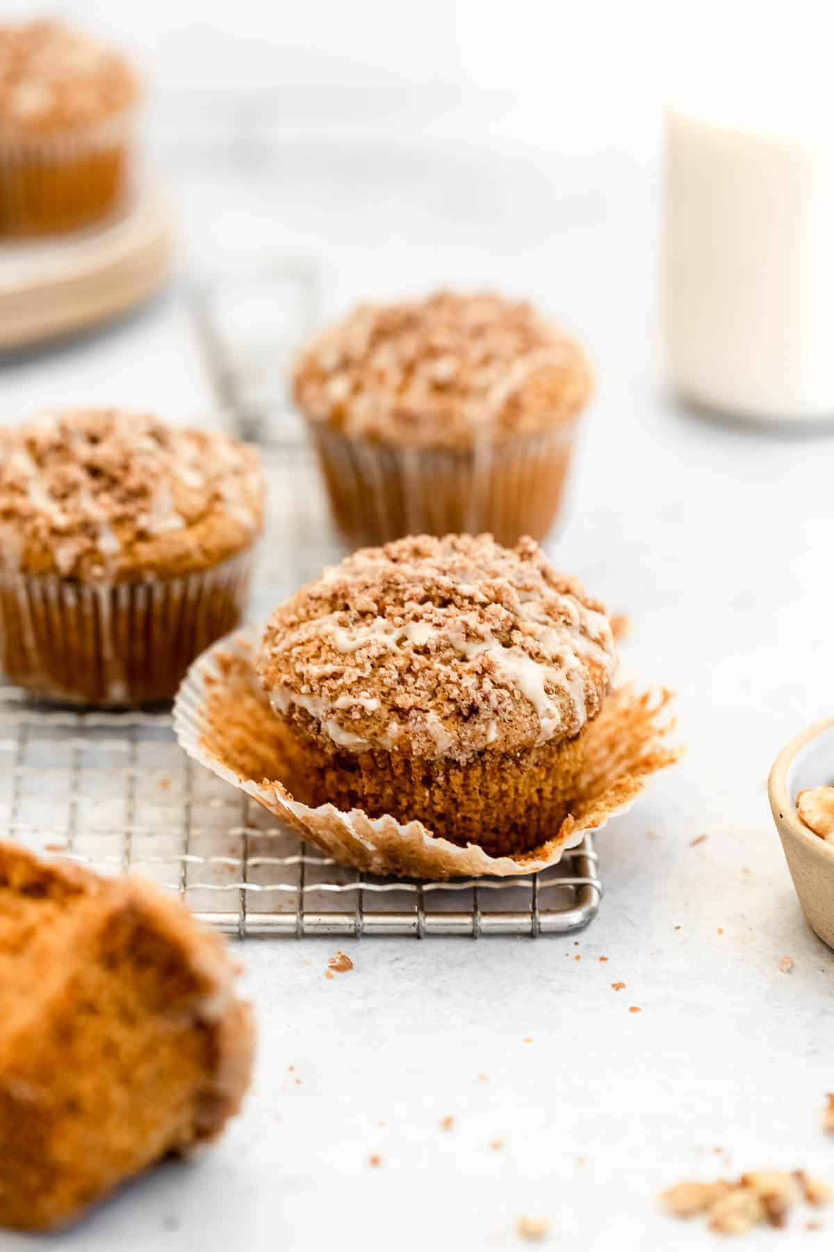 gluten free carrot cake muffins on a wire rack