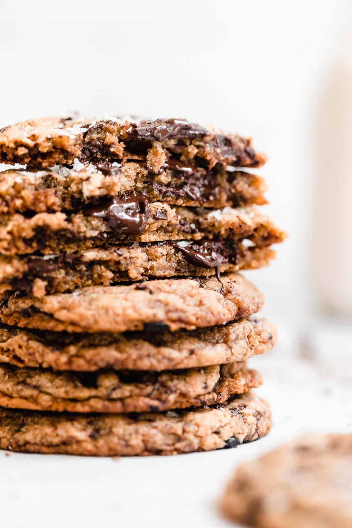 vegan tahini cookies stacked on each other with melted chocolate