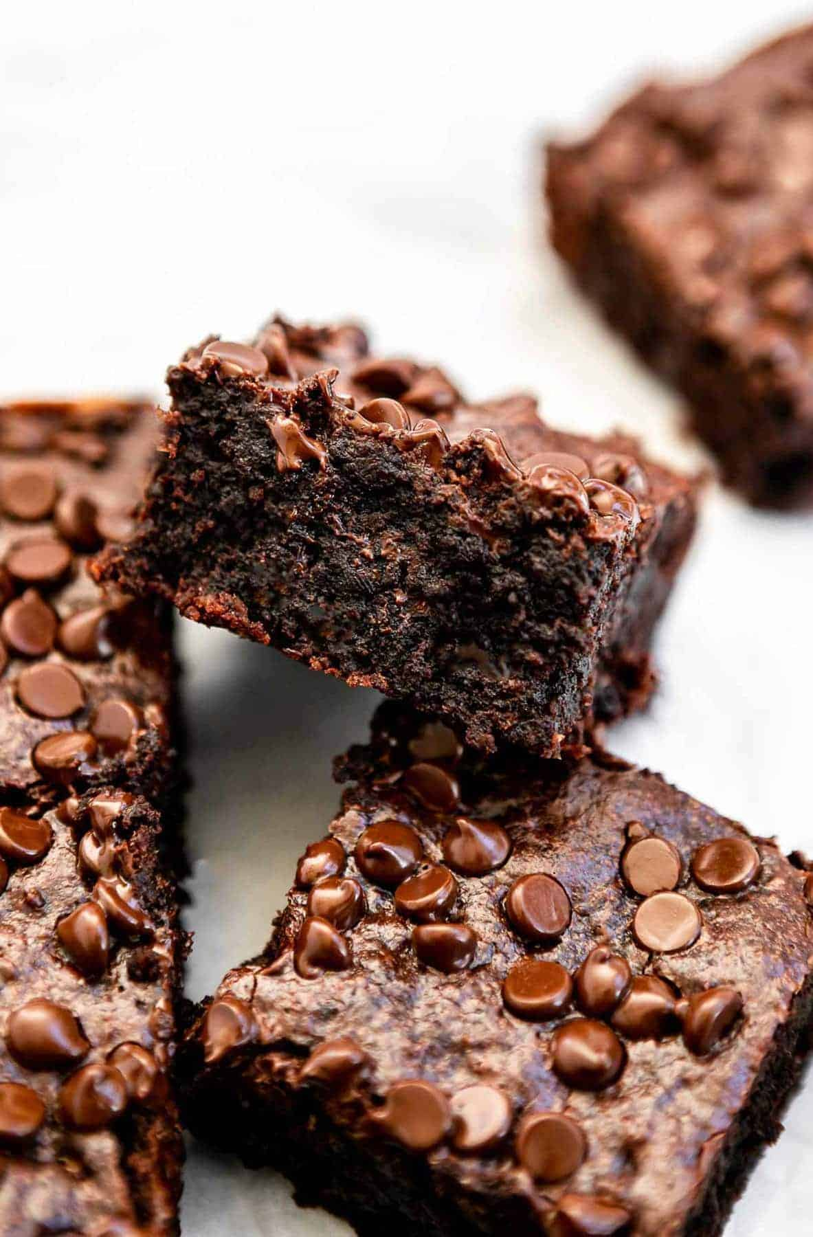 one paleo brownie on the side to show fudgy texture