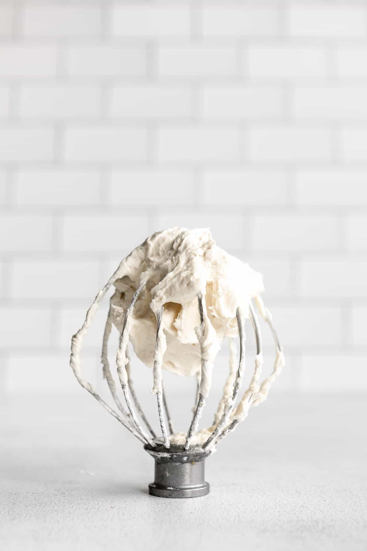 whisk with the frosting on top