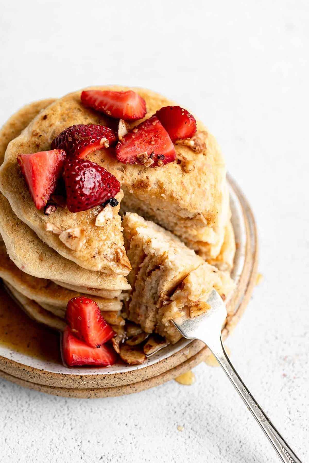 vegan protein pancakes with one bite taken out to show texture