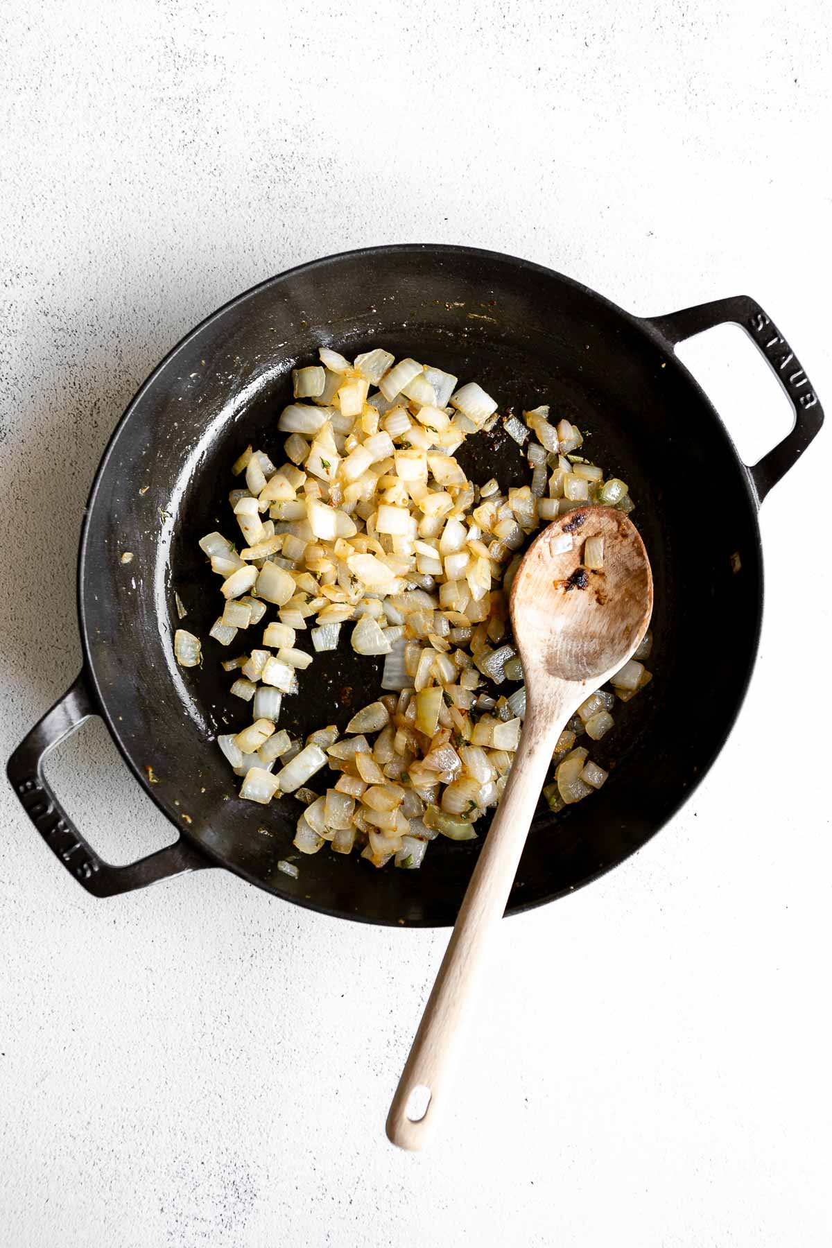 onion sauteeing in a black pot