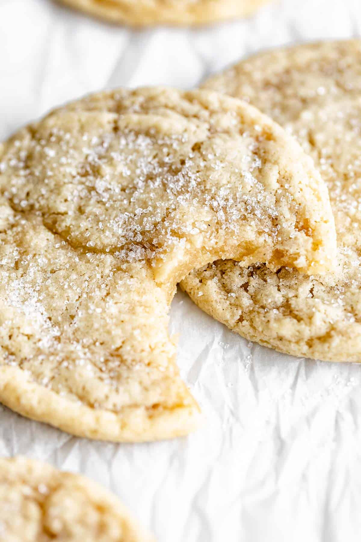 gluten free sugar cookies with a bite taken out to show texture