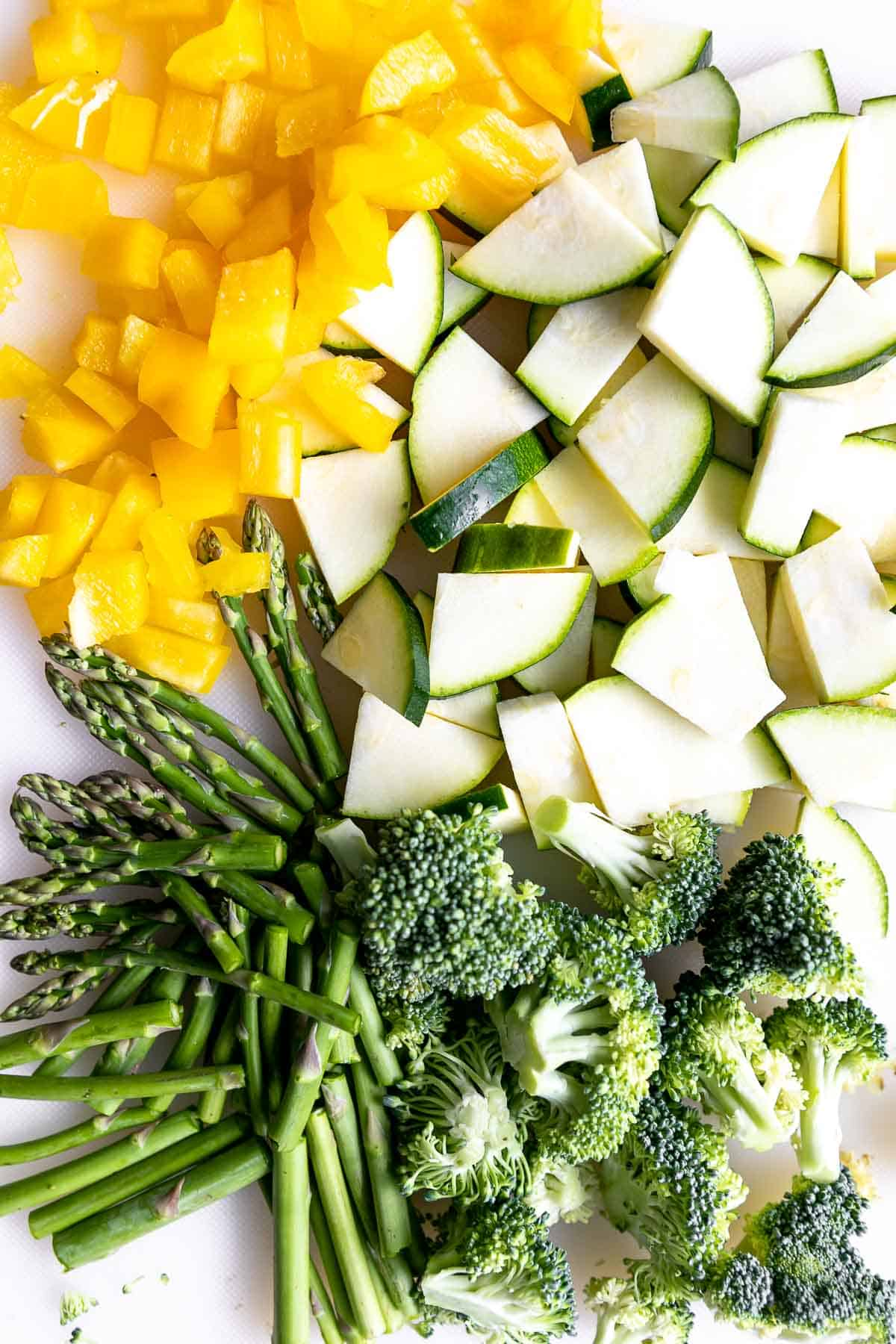 diced vegetables on a white cutting board