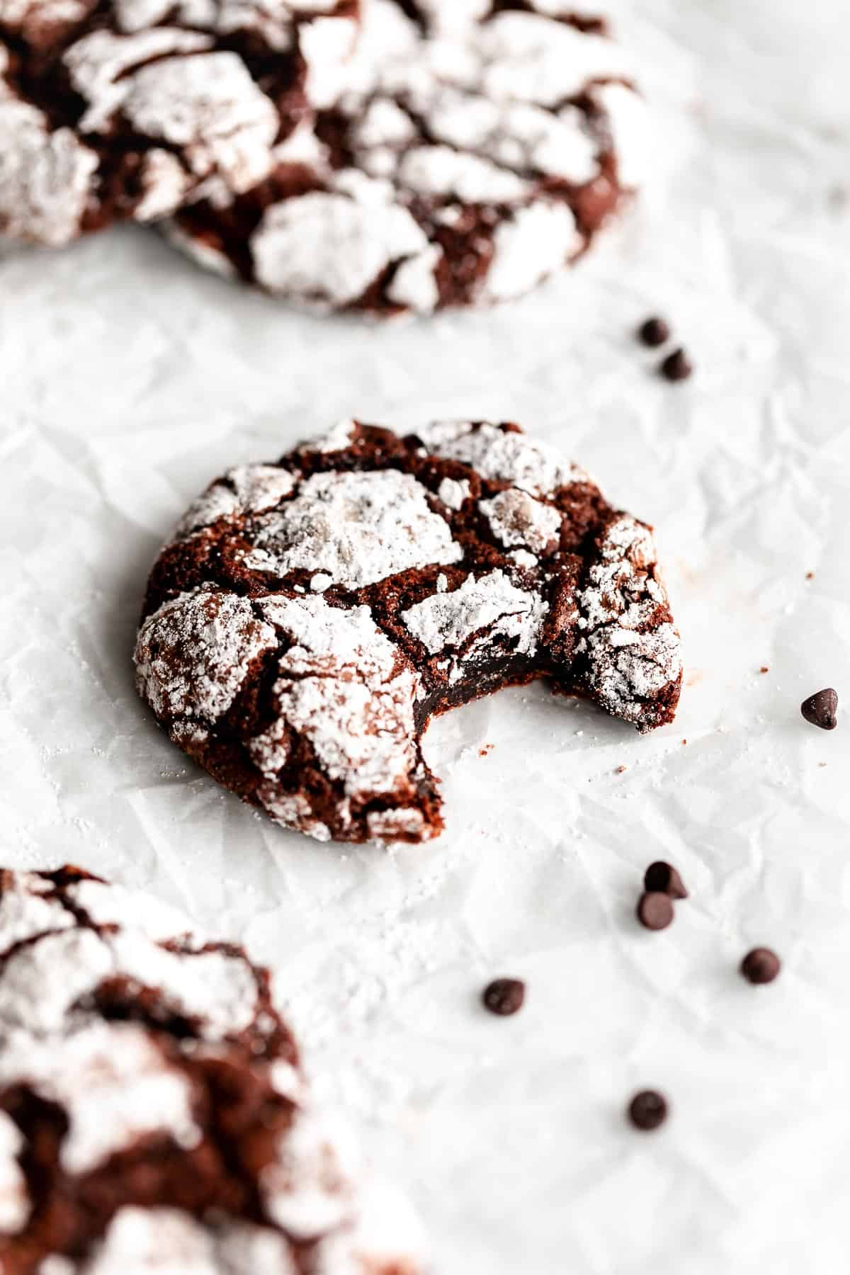 gluten free chocolate crinkle cookies with a bite taken out
