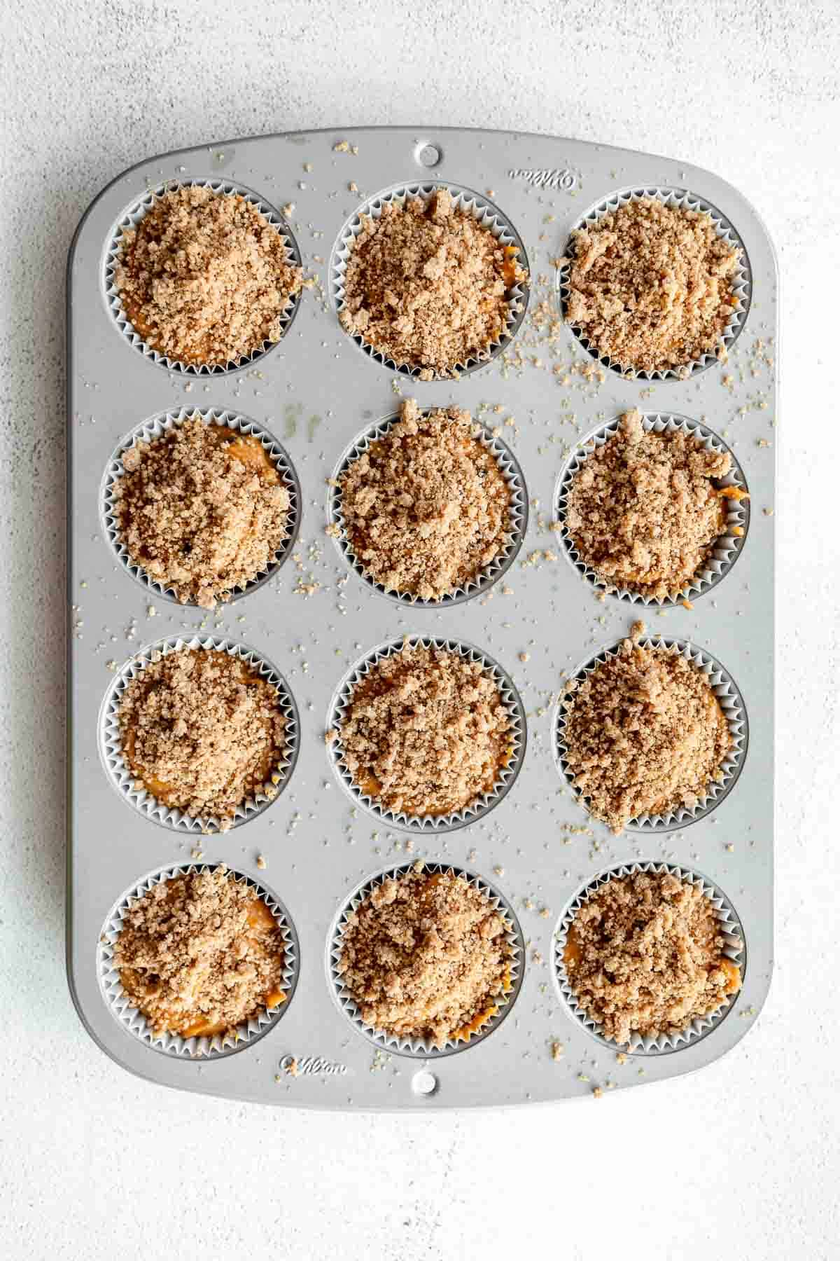 pumpkin muffins in a muffin tray before going in the oven