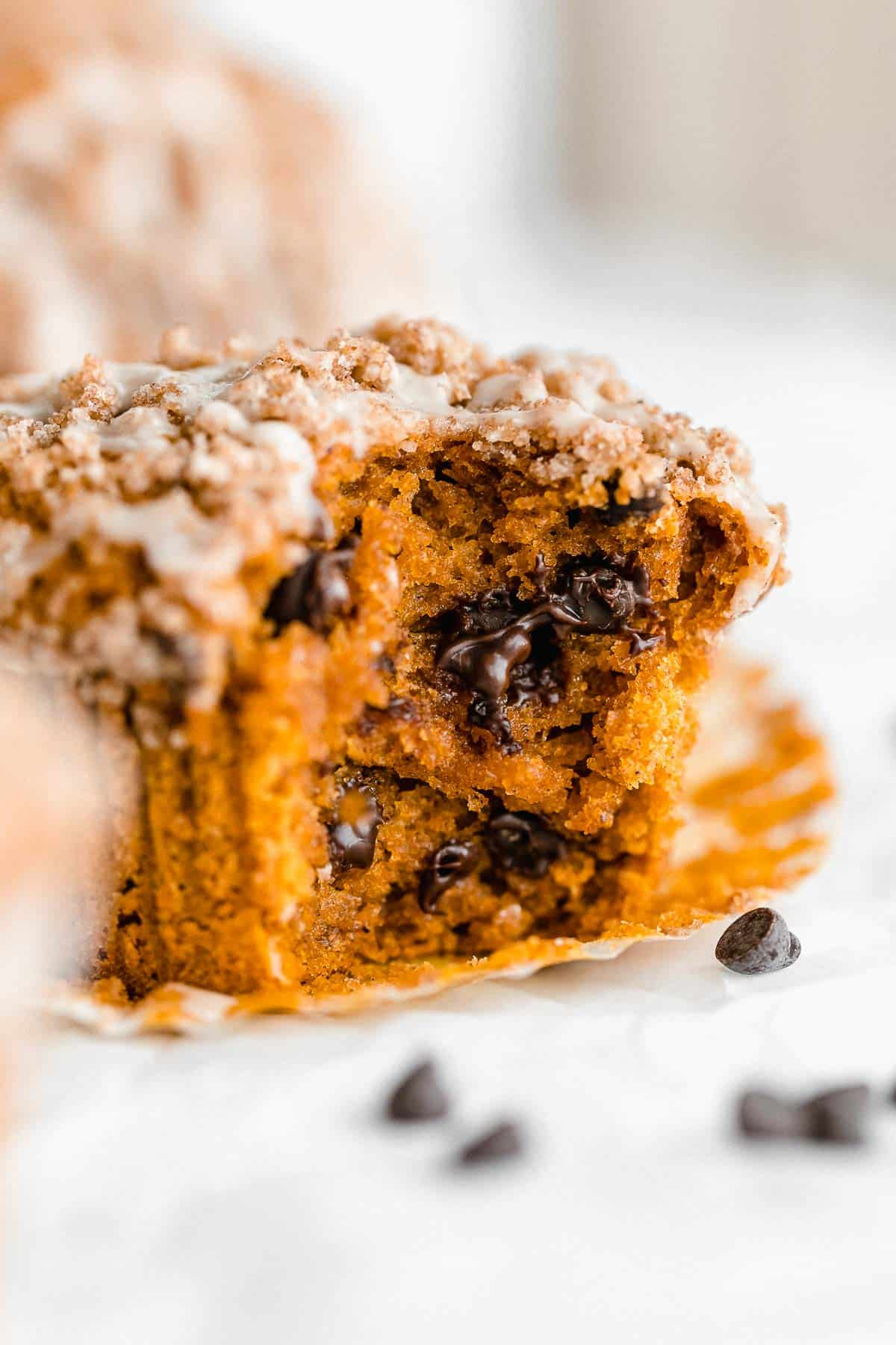 up close of one muffin with a bite taken out to show texture
