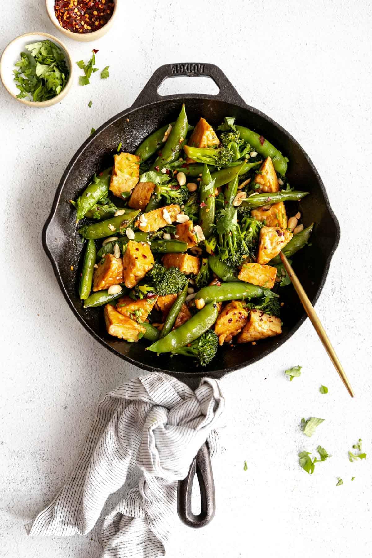 vegan tempeh stir fry with peanuts in a skillet