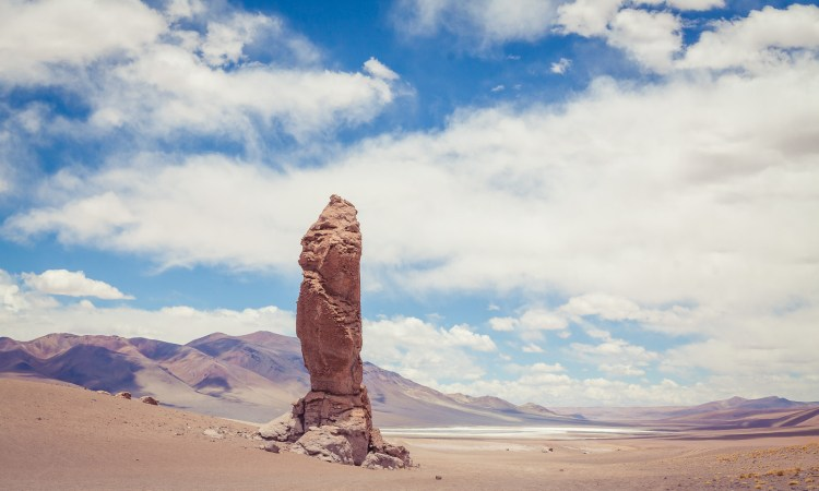 Relaxing at Monjes de la Pacana - Atacama Desert, Chile - | www.eatworktravel.com