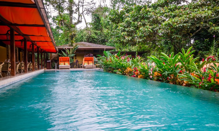 The Nayara Hotel & Spa in Arenal, Costa Rica is the ultimate spot for luxury and romance! This gorgeous property has no shortage of secluded spots for privacy and is close to the main attractions in the area. | www.eatworktravel.com - The luxury, adventure couple!