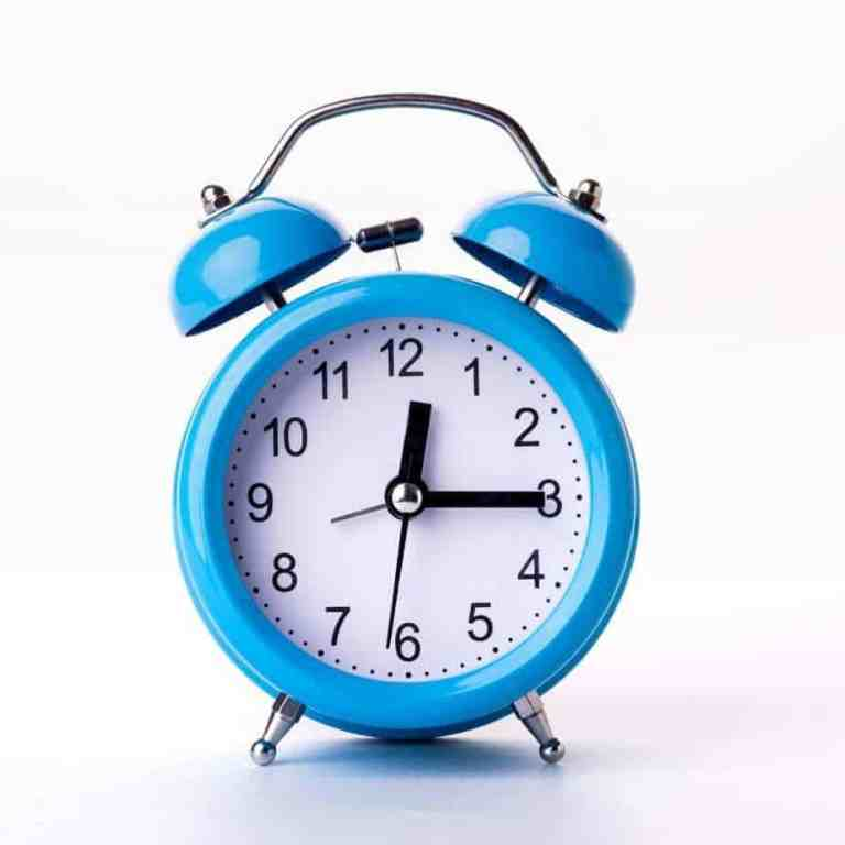 Blue alarm clock symbolizes time management strategies to boost your productivity.