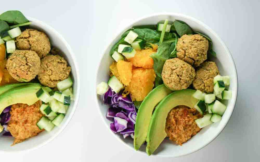 Quick, fresh and Easy falafel bowls with roasted squash, avocado and harissa hummus recipe. A perfect healthy dinner. Absolutely delish and satisfying.