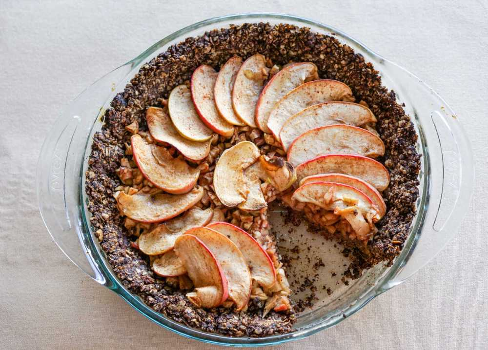 Apple Tart with Drop Cookie Crust Recipe: Warm spiced apples wrapped in a comforting chocolate drop cookie crust. Gluten, dairy, and refined sugar free.