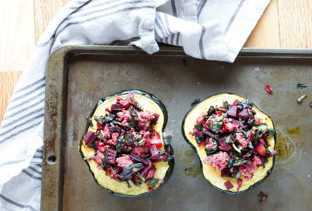 A healthy paleo and whole 30 friendly dinner idea: Beet, Dandelion and Grass-Fed Beef Stuffed Acorn Squash recipe full of protein,vegetables and greens